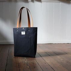 Meet the Auburn Tote... Your on the go quick tote with a rounded pocket. Bound seams and Horween leather same craftsmanship and quality materials as the bigger totes. #horween #totebag #selvedge #pinstripe #beach by starkmade