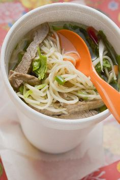 Asian noodle soup with beef to go