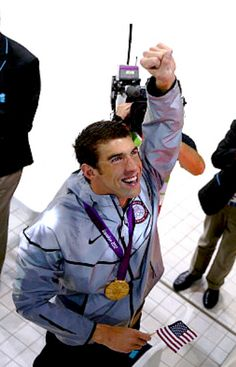 Michael Phelps after receiving his Olympic medal, which made him the most decorated Olympian of all time. Michael Phelps, Olympic Medals, Olympic Sports, Olympic Games, Swimming World, I Love Swimming, Olympic Swimmers, Olympic Athletes