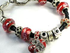AMAZING Black Leather Braided Bracelet, Black Swarovski Crystal Beads, Red Rose Glass Lampwork, Enameled Red/Silver Masquerade Mask Charm by Chris of FantasyDesign, $35.00