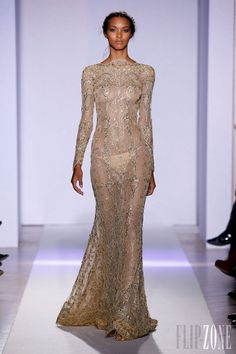 Zuhair Murad - Couture - Official pictures, S/S 2013 - http://en.flip-zone.com/fashion/couture-1/fashion-houses/zuhair-murad-3366 - Long-sleeve dress, plunging neckline and fluid train in gold lace.