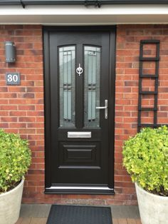 Black Jacobean Empire Rockdoor composite door with matching black frame. Diy Sliding Door, Modern Sliding Doors, Diy Door, Black Composite Front Door, Composite Door, Fromt Doors, Barn Door Tables, Front Door Porch, Glass Panel Door