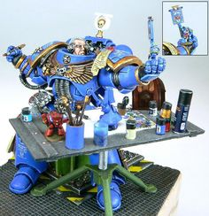 Space Marine painting a Space Marine - Epic! (and a must have in any photo collection of the hobby)