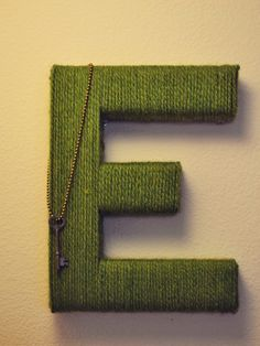 cardboard letters covered in yarn