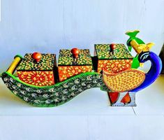 Amaze your guests by serving in this beautiful handicraft dry fruit box with the royal Rajasthani look. This vibrant colored peacock shaped dry fruit box with elegant design and graceful look can also be used as a jewelry box or a home decor item. Summer Arts And Crafts, Arts And Crafts For Adults, Arts And Crafts House, Easy Arts And Crafts, Crafts For Seniors, Crafts For Boys, Arts And Crafts Projects, Diy Crafts, Diwali Decoration Items