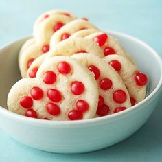 Red cinnamon candies top these sugar cookie cutouts. Kids love this ...