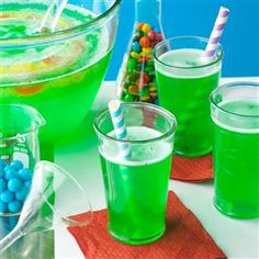 Magic Potion Punch Recipe -At a Halloween party, the more creepy the food, the better! I like to tuck gummy worms into an ice ring when I make this great green punch.                                           — Michelle Thomas, Bangor, Maine