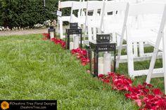 !boulanger-07-le-chateau-wedding-flowers-ceremony-aisle-lanterns-candles-rose-petals-red.