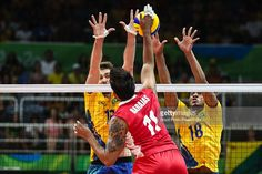 Jorge Barajas of Mexico and Lucas Saatkamp and Ricardo Lucarelli of Brazil during the men's qualifying volleyball match between Brazil and Mexico on August 7, 2016 in Rio de Janeiro, Brazil.