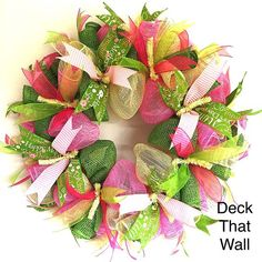 This beautiful Mother's Day Wreath was made with three different colors of mesh, featuring Pink, Ivory, and Green Poly Burlap. There are four ribbons featured on the wreath, all of which are wired for