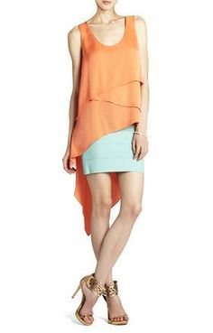 BCBG hi-lo blouse in orange perfect for the warmer temperatures, now available at Steamroller Blues $158  #bcbg #orange #steamrollerblues #weship