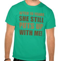 10th Anniversary Humor T-Shirt For Men that says, 'after 10 years she still puts up with me'.