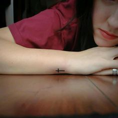 simple cross tattoo . Love The Placement !