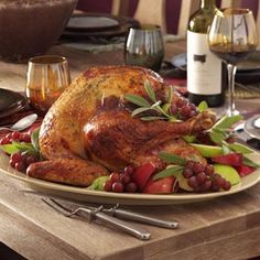 Apple-Sage Roasted Turkey Recipe_    Apple flavor gives this classic recipe a new spin that will appeal to even your pickiest eaters. The lovely aroma as this moist and beautiful turkey cooked in the kitchen had everyone talking.