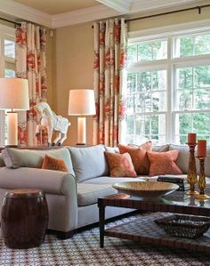Cream living room with blue-gray, rich brown and rust red. Classic elegance perfectly mixed with exotic patterns. No lack of natural light either.