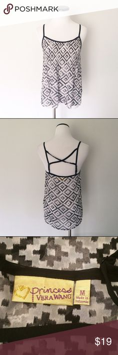 "Princess VERA WANG Black white Tank Top Gently worn. Black and white sheer tank top. Adjustable straps in back. Princess Vera Wang. Length in front 18"". Chest 17"", it was hard to measure because the type of fabric. That is stretched a little bit. 100% polyester. Vera Wang Tops Tank Tops"