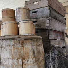 Old barrel and boxes in the boathouse