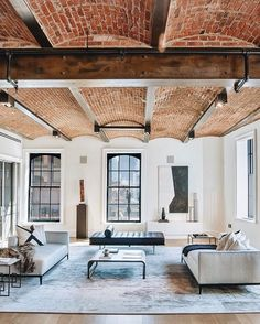 Cool architectural details: exposed brick ceilings with wood beams