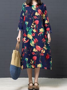 c94a06f8476 Pockets Print Loose Long Sleeve Mid-long Vintage Dresses is high-quality