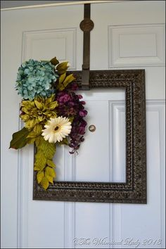 Picture Frame Wreath: never thought about this… This will look so much better on my door since I have a window on my door. Duh!!