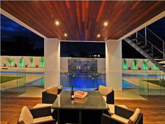 Indoor-outdoor outdoor living design with glass balustrade & decorative lighting using timber - Outdoor Living Photo 366530