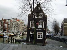 De Sluyswacht, A skewed portrait lock keepers cottage in the Centre of Amsterdam #Amsterdam #Holland