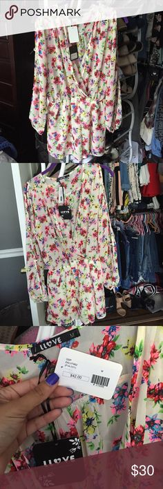 Floral romper Never worn, new with tags. Bright floral romper Llove Other