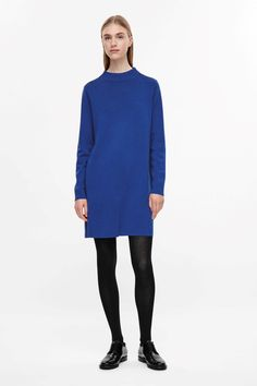 Made from a fine knitted merino wool, this dress has a tight, round neckline. An casual A-line fit, it is completed with long sleeves, a neat straight hemline and minimal finishes.