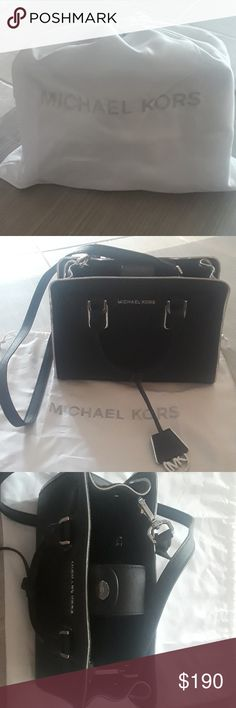Michael Kors small Safianno black leather Small handbag perfect for a night out. Used once and decided it was too small for my everyday use. It has been in my closet inside the dust bag (included). Michael Kors Bags Satchels