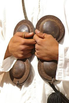 """iron castanets used by Gnawa musicians in Morocco.  www.asilahventures.com """"Morocco Specialist"""""""