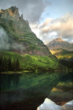 Pyramid Peak and Stoney Indian Pass rise over Lake Mokowanis on an early morning after a storm in Glacier National Park, Montana. | Photog by Mark Genito.