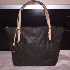 Michael Kors Brown PVC Signature Top Zip Tote Bag Used a couple of times. Excellent condition. No stains, no holes Michael Kors Bags Totes