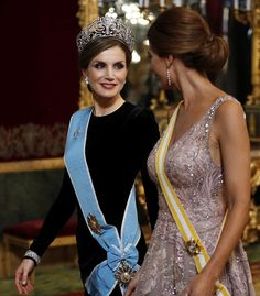 Spanish Queen Letizia chose an understated black dress for tonight's event, but made up for her lack of sparkle by donning the crown jewels as she received Argentina's very glamorous First Lady Juliana Awada in a fairytale dusky pink gown with intricate floral embroidery and tiny sparkling crystals as the Spanish royals host a glittering gala dinner at the Royal Palace