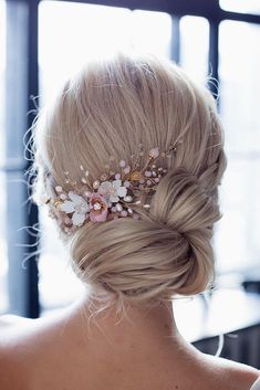bridal hair accessories to inspire hairstyle low updo with white and pink flowers annamelostnaya via instagram
