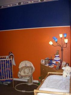 i like the color scheme and the 'crown molding' use of the gator banner wallpaper. May be more appropriate for a older child (about 10 or so) as opposed to a baby because the color seems dark