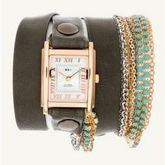 Made from supple, slate gray Italian leather, this size-able wristband hits the jewelry note thanks to numerous bejeweled chains directly attached to one end, but also gets functional by sporting a watch case made of rose gold. #jewelry #bracelet #gold