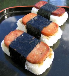 """Front to back: SPAM, TULIP and TREET Musubi Back in 2003, a new kid, umm, make that can in town entered Hawaii's ever-popular luncheon meat market by the name of Tulip Luncheon Hash """"with Real Bacon"""". With Hawaii statistically being…"""
