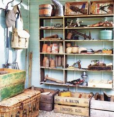 garden shed...takes up less space than the shelving unit and provides more space for items in the potting shed....what do you say?