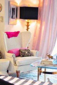 Love the curtains, wall color, chair and especially the lamp! Could skip the hot pink pops.