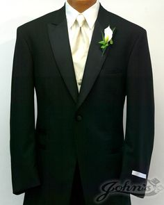 I like the cream tie, white shirt, black tux