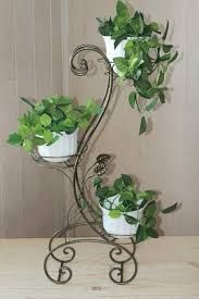 Forged flower stands – photo examples - New Deko Sites House Plants Decor, Plant Decor, Bottle Garden, Garden Pots, Wrought Iron Decor, Decoration Plante, Iron Plant, Diy Plant Stand, Grill Design