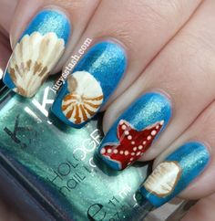 Hand painted art nails depicting shells and the beach!