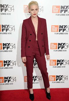 Kristen Stewart made a strong case for suiting up in a wine-coloured, tapered leg and double-breasted number, featuring a peek of flesh with an unbuttoned blazer (do you dare?). Finish with a longline necklace, badass pointed booties and a pout to match