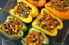 Mexican Qunoa Stuffed Peppers! Fiesta-flavored quinoa is stuffed into these pretty pepper packages for an awesome, easy meal (vegan, gluten-free)