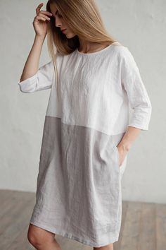 Soft and washed loose fitted linen dress with 3/4 sleeves and 2 hidden side pockets in colour block (white and light gray). This pure linen tunic dress will keep you covered up from the sun while still staying cool, thanks to linen's great breathable quality. Features: - round neck - 3/4