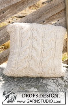 "DROPS 117-53 - Knitted DROPS cushion cover with cables in ""Polaris"". - Free pattern by DROPS Design"