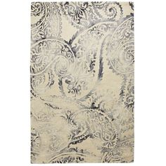 Impressive paisley motifs play opposite subdued colors. Handmade by tufting and dip-dying, this 100% wool rug delivers traditional Indian designs along with a beautifully faded appearance. And that's how cross-generational appeal is done.