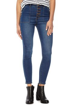 the skinny high rise 7/8 jean with button fly and square pocket detail.