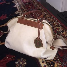 Dooney and Bourke canvas bag. In good used condition.  Shoulder and hand bag. Dooney & Bourke Bags Shoulder Bags