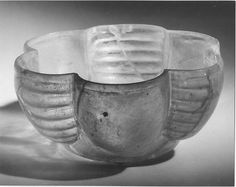 Bowl Date: 8th–9th century Geography: Iran Culture: Islamic Medium: Glass, colorless with greenish tinge; mold blown, cut Dimensions: H. 2 7/16 in. (6.2 cm) Diam. 5 7/16 in. (13.9 cm) Th. at rim of lobe 1/8 in. (.3 cm)